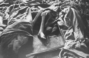 Corpses of women piled up on the floor of Block 11. (February 1945)