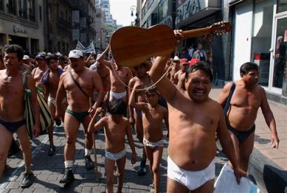 Naked Mexican farmers demand their lands back (AP/Eduardo Verdugo)