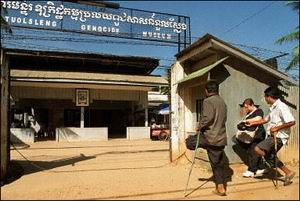 Amputees beg from a tourist at the entrance to the Tuolsleng Genocide Museum in Phnom Penh.