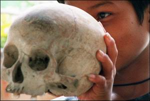 Cambodians have begun commemorations marking the 30th anniversary of the Khmer Rouge rise to power. In this file picture a Cambodian child displays the skull of a Khmer Rouge victim at the Choeung Ek genocide memorial, 10 kilometers from Phnom Penh.